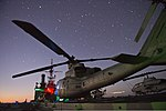 U.S. Marine Corps UH-1Y Venom and AH-1W Super Cobra helicopters attached to Marine Medium Tiltrotor Squadron (VMM) 265 are shown on the flight deck of the amphibious transport dock ship USS Denver (LPD 9) in 130807-N-KL846-034.jpg