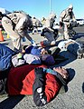 U.S. National Guardsmen assigned to the Chemical, Biological, Radiological, Nuclear and high-yield Explosives Enhanced Response Force Package, Oregon National Guard assist injured victims near Joint Base 140327-Z-CH590-229.jpg