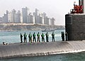 U.S. Sailors aboard the attack submarine USS Cheyenne (SSN 773) stand ready as the boat arrives in Busan, South Korea, March 20, 2013 130320-N-TB410-186.jpg