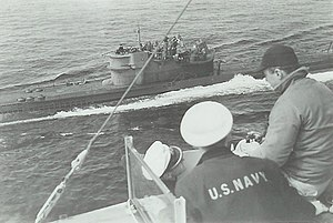 U-234 surrendering. Crewmen of USS Sutton in foreground