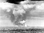 USS Franklin (CV-13) burning in the distance 1945.jpg