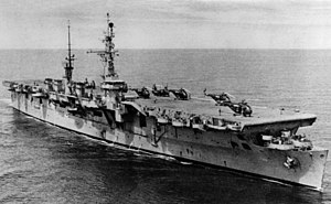 USS Saipan (CVL-48) at sea with helicopters embarked, circa in 1955 (NH 67747).jpg
