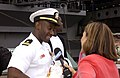 US Navy 020603-N-6753L-006 Lt. Raymond Hanna, holding his daughter for the first time, shares the joy of a his homecoming with a local Fox News reporter.jpg