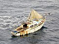 US Navy 020917-N-0000X-028 Sailboat adrift at sea after U.S. Navy rescue.jpg