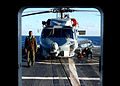 US Navy 021102-N-3235P-503 Crewmembers assigned to Helicopter Anti-Submarine Squadron Light Four Eight (HSL-48), Detachment Six, ensure that their SH-60B Seahawk helicopter is secured.jpg