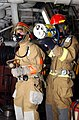 US Navy 030130-N-5821P-002 simulated checking for fire in a smoke-filled room using the Naval Firefighting Thermal Imaging device.jpg