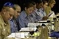 US Navy 030417-N-8273J-010 Crewmembers read from the Passover Hagaddah (prayer book) during the Passover Seder dinner in the wardroom aboard USS Nimitz (CVN 68).jpg