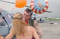 US Navy 030725-N-7805K-002 Lt. j.g. Aaron Kemp is met on the flight line by his wife carrying Welcome Back balloons during the homecoming celebration for the War Lords of Helicopter Anti-Submarine Squadron Light Five One (HSL-5.jpg