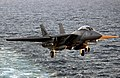US Navy 040322-N-5319A-004 An F-14B Tomcat assigned to the Red Rippers of Fighter Squadron One One (VF-11) approaches the flight deck of USS George Washington (CVN 73) during evening flight operations.jpg