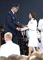 US Navy 040528-N-9693M-015 Newly commissioned Ensign Colleen Maloney, from Canton, Ohio, receives her diploma from the Chairman of the Joint Chiefs of Staff Gen. Richard B. Meyers at the U.S. Naval Academy.jpg