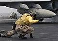 US Navy 040714-N-9742R-034 USS Enterprise (CVN 65) Catapult Officer Lt. Pamela Nickrand, from Jacksonville, Fla., gives the signal to launch an F-A-18 Hornet.jpg
