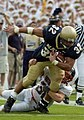 US Navy 040911-N-9693M-003 U.S. Naval Academy Midshipman 1st Class Kyle Eckel is tackled by Northeastern Huskies' Gavin Potter.jpg