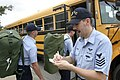 US Navy 040914-N-4204E-055 Aviation Electronics' Technician 1st Class Phillip Crosby musters students assigned to Naval Aviation Technical Training Center (NATTC) as they head for buses.jpg