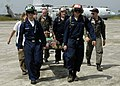 US Navy 050103-N-9951E-151 Sailors, assigned to USS Abraham Lincoln (CVN 72) and Carrier Air Wing Two (CVW-2), carry a patient on a stretcher flown-in by a U.S. Navy helicopter.jpg