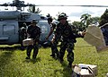 US Navy 050104-N-6817C-105 Indonesian Military personnel work together to unload an SH-60B Seahawk helicopter during a humanitarian aid mission to Aceh, Sumatra, Indonesia.jpg