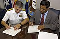 US Navy 050804-N-7676W-004 Chief of Naval Research, Rear Adm. Jay Cohen and Deputy Chief Defence Scientist (Systems) Corporate Leader Maritime, Dr. D. (Nanda) Nandagopal, sign letters of Cooperation.jpg
