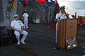 US Navy 050908-N-1332Y-125 Commanding Officer, USS Fitzgerald (DDG 62), Cmdr. David Hughes, gives his remarks to his crew during his change-of-command ceremony on the flight deck.jpg