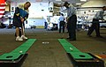 US Navy 050911-N-5914D-002 Information Systems Technician Seaman Raquell Johnson and Richard Michelsen practice their putting skills in the ship's hangar bay.jpg