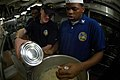 US Navy 050927-N-9551Z-004 Culinary Specialist 3rd Class Paul Joseph, left, and Aviation Ordnanceman Airman Sean Carlson, whip mashed potatoes in the wardroom galley aboard the conventionally powered aircraft carrier USS Kitty.jpg