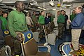 US Navy 060130-N-2568S-173 Secretary of the Navy (SECNAV), the Honorable Dr. Donald C. Winter, talks with Sailors from Strike Fighter Squadron Fifteen (VFA-15), aboard Nimitz-class aircraft carrier USS Theodore Roosevelt (CVN 7.jpg