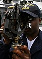 US Navy 060504-N-4953E-026 Quartermaster 3rd Class Dan Finklea uses the Sextant to determine the height and the angle of celestial bodies to find the position and heading of the guided missile destroyer USS Stethem (DDG 63) whi.jpg