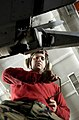 US Navy 070317-N-7130B-039 Perched atop a ladder in the hangar bay of the Nimitz-class aircraft carrier USS Ronald Reagan (CVN 76), Aviation Ordnanceman Airman Eric Blanchard uses a speed wrench to quickly reinstall fuselage fa.jpg