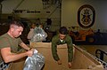 US Navy 071127-N-1831S-202 Marines aboard USS Kearsarge (LHD 3) load water into boxes that will be delivered to the damaged areas. Kearsarge and embarked 22nd Marine Expeditionary Unit.jpg