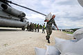 US Navy 080908-N-9774H-808 Service members offload supplies to provide disaster relief support in areas affected by recent tropical storms.jpg