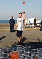 US Navy 081103-N-6282K-229 Aviation Boatswain's Mate (Handling) Airman Timothy Sheets participates in a carnival game.jpg