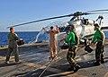 US Navy 081217-N-1082Z-049 Lt. Scott Miller is cooled off by Sailors aboard USS Vella Gulf (CG 72).jpg