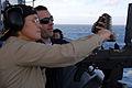 US Navy 090119-N-1688B-300 Capt. Cindy Thebaud, commander, Africa Partnership Station (APS) 2009, receives training on the M-240 machine gun while aboard the amphibious transport dock ship USS Nashville (LPD 13).jpg