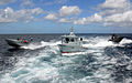 US Navy 090319-N-4143O-003 mall boats participate in a high value asset escort exercise off the coast of Barbados at the culmination of a two-week Southern Partnership Station waterborne security course taught by members of the.jpg