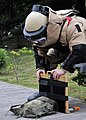 US Navy 090512-N-2013O-070 xplosive Ordnance Disposal Technician 1st Class Taylor King, from Concorde, N.C., a member of Explosive Ordnance Disposal Mobile Unit 5, Det. Japan, prepares X-rays a simulated improvised explosive de.jpg