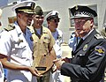 US Navy 090529-N-9740S-273 apt. Sam Howard, commanding officer of the multi-purpose amphibious assault ship USS Bataan (LHD 5), presents Palma De Mallorca Police Chief Nicolas Herrero with a plaque.jpg