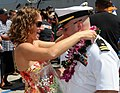 US Navy 090720-N-3666S-091 A Sailor assigned to the Arleigh Burke-class guided-missile destroyer USS Chung-Hoon (DDG 93) embraces his wife pier side at Naval Station Pearl Harbor.jpg