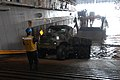 US Navy 090725-A-1839I-013 Seaman Tyree Evans directs a Marine as he drives a vehicle onto a Brazilian Navy Landing Craft.jpg