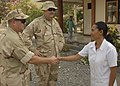 US Navy 091015-N-4128S-037 Capt. Timothy Wilson and Cmdr. Steven Gabele meet with a Timorese dentist at a dental community service program site during Marine Exercise (MAREX) 2009.jpg