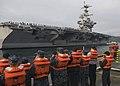 US Navy 091123-N-5253W-011 Line handlers on the pier await the arrival of the aircraft carrier USS George Washington (CVN 73) as the ship returns to Commander Fleet Activities Yokosuka.jpg