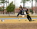 US Navy 091212-N-5328N-307 ryptologic Technician (Technical) Seaman Recruit Jesse Wilson intercepts a football during the seventh annual Flag Football game between Army and Navy.jpg
