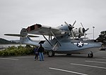 US Navy 100625-N-9520G-004 A father and daughter look at a World War II-era PBY-5A seaplane at Simard Hall at the Naval Air Station Whidbey Island Seaplane Base.jpg