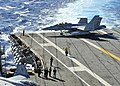 US Navy 100808-N-0569K-059 ircraft directors move an F-A-18F Super Hornet assigned to the Fighting Checkmates of Strike Fighter Squadron (VFA) 211.jpg