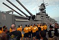 US Navy 100816-N-6676S-011 Chief petty officer (CPO) selectees from local commands listen to a tour guide explain the history of the Battleship Wisconsin.jpg