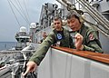 US Navy 100818-N-5595G-031 Capt. Daniel Grieco, executive officer of the aircraft carrier USS George Washington (CVN 73), explains the function and capacities of the arresting gear to Col. Tan Ah Kheng.jpg