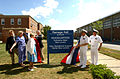 US Navy 100820-N-5188B-030 Alfred Ramage, left, Virginia Ann Ramage-Ross, Dr. Joan Ramage-Mitchell and James L. Ramage stand with Capt. Marc Denno and Command Master Chief Ray Powell unveil the Ramage Hall sign at Submarine Bas.jpg