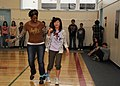 US Navy 110416-N-2653B-097 Yeoman 1st Class Sonya Davis participates in a three-legged race with a Japanese child during a cultural-exchange event.jpg