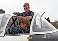 US Navy 110726-N-OX023-017 Lt. j.g. Chris Bworjan, the Air Wing (TRAWING) 4 scheduling officer for training, instructs U.S. Naval Academy Midshipma.jpg