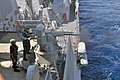 US Navy 111014-N-YZ751-066 Gunner's Mate Seaman Apprentice Lauren C. Hanley fires a MK-38 25 mm machine gun aboard the guided-missile destroyer USS.jpg
