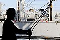 US Navy 111027-N-HU799-145 A Sailor rigs lines before transporting cargo via sliding padeye to the Military Sealift Command fast combat support shi.jpg