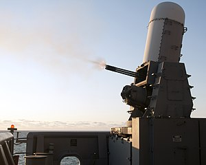 US Navy 120201-N-ZZ999-089 A close-in weapons system (CWIS) fires a burst of tungsten rounds aboard the amphibious assault ship USS Wasp (LHD 1) du.jpg