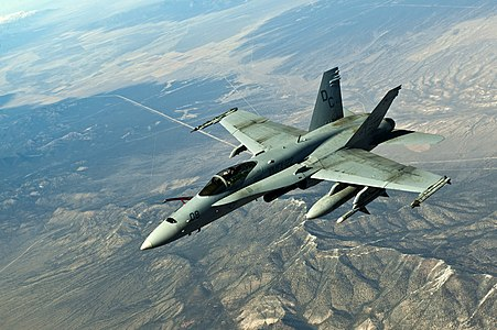 AA F/A-18 Hornet, U.S. Marine Corps, flies in a training mission during Red Flag 12-3 March 9, 2012, over the Nevada Test and Training Range. Members of the RAAF participate in the Red Flag exercise every other year